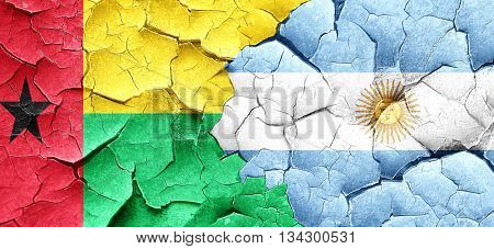 Guinea bissau flag with Argentine flag on a grunge cracked wall
