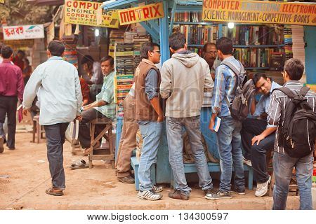 KOLKATA, INDIA - JAN 15, 2016: Students looking for the different books at outdoor book market on January 15, 2016 in Kolkata. From 1976 Kolkata have the Book Fair with 2 million visitors annual.