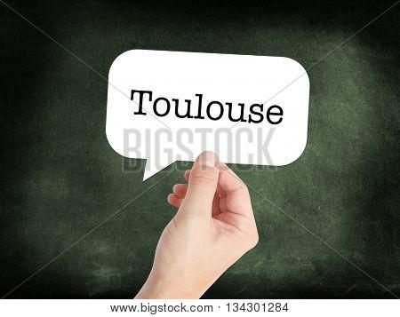 Toulouse written in a speech bubble