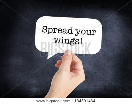 Spread your wings written on a speechbubble