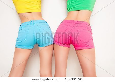Close Up Photo Of Sexy Woman's Backs In Color Shorts