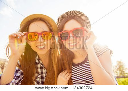 Portrait Of Beautiful Girls With Beamings Smiles Wearing Spectacles
