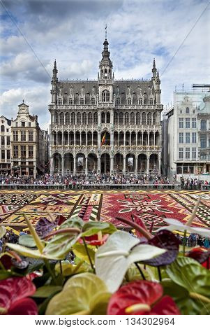 BRUSSELS BELGIUM - AUGUST 16 2012: King House building during Flower Carpet Festival. This biannual event takes place at the Grand Place and this year design of the carpet was in honor of Africa.