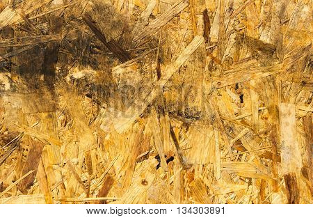 unusual background of pressed residues from the processing of wood. Used as a building material