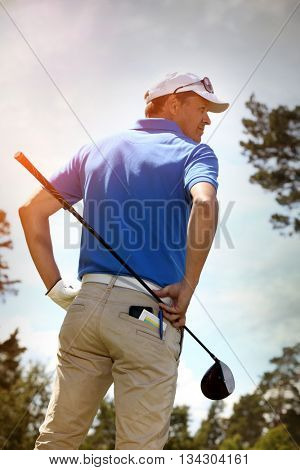 Golf player against sky