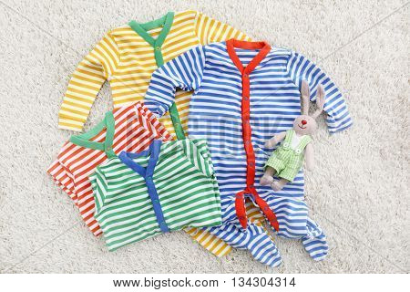 Baby body clothes on light background
