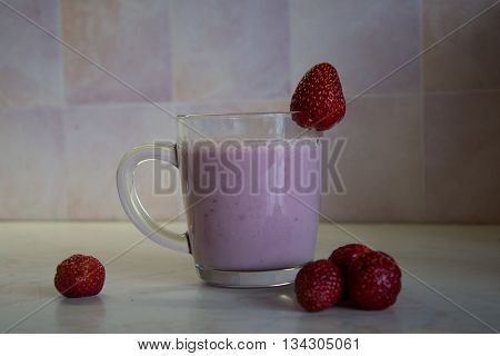 strawberry milk shake with strawberries in the kitchen