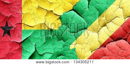 Guinea bissau flag with congo flag on a grunge cracked wall