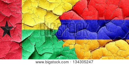 Guinea bissau flag with Armenia flag on a grunge cracked wall