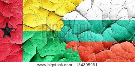 Guinea bissau flag with Bulgaria flag on a grunge cracked wall