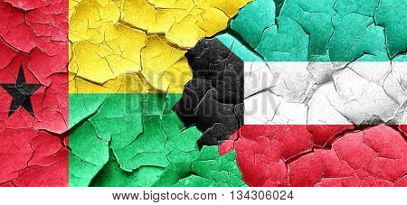 Guinea bissau flag with Kuwait flag on a grunge cracked wall