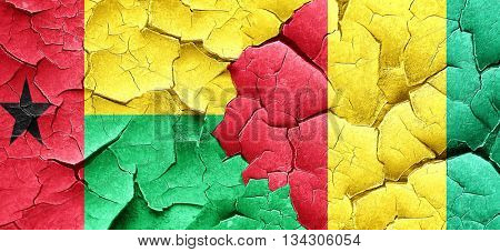 Guinea bissau flag with Guinea flag on a grunge cracked wall