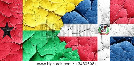 Guinea bissau flag with Dominican Republic flag on a grunge crac