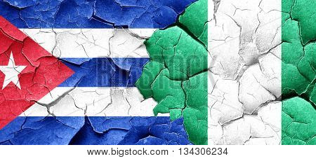 Cuba flag with Nigeria flag on a grunge cracked wall