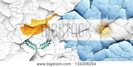 Cyprus flag with Argentine flag on a grunge cracked wall