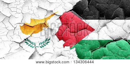 Cyprus flag with Palestine flag on a grunge cracked wall