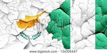 Cyprus flag with Nigeria flag on a grunge cracked wall