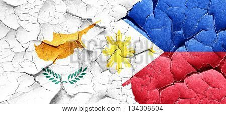 Cyprus flag with Philippines flag on a grunge cracked wall