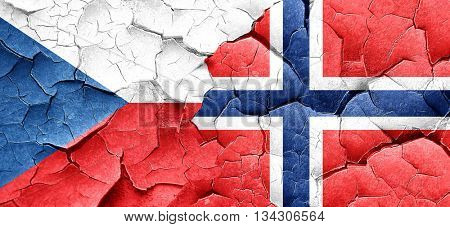czechoslovakia flag with Norway flag on a grunge cracked wall