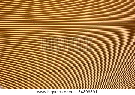 Hypnotic colorful building wall. Metallic pattern, background.