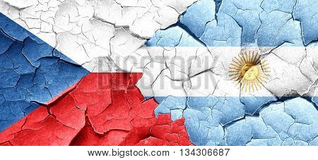 czechoslovakia flag with Argentine flag on a grunge cracked wall
