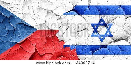 czechoslovakia flag with Israel flag on a grunge cracked wall