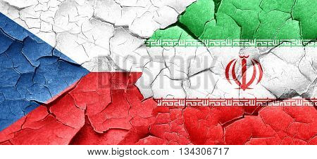 czechoslovakia flag with Iran flag on a grunge cracked wall