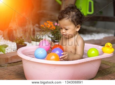 Asian Baby Bathing In Tubs