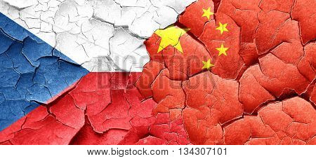 czechoslovakia flag with China flag on a grunge cracked wall