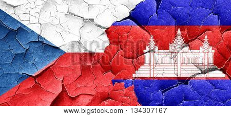 czechoslovakia flag with Cambodia flag on a grunge cracked wall