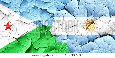 Djibouti flag with Argentine flag on a grunge cracked wall