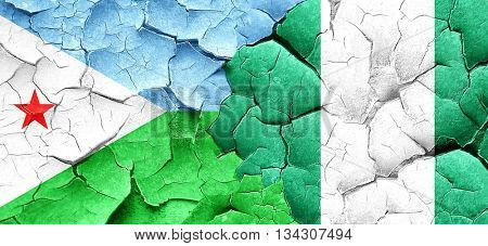 Djibouti flag with Nigeria flag on a grunge cracked wall