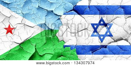 Djibouti flag with Israel flag on a grunge cracked wall