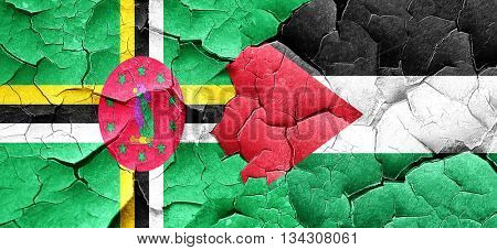 Dominica flag with Palestine flag on a grunge cracked wall