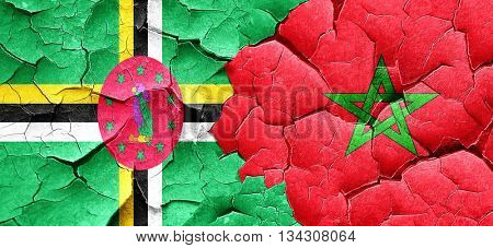 Dominica flag with Morocco flag on a grunge cracked wall