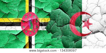 Dominica flag with Algeria flag on a grunge cracked wall