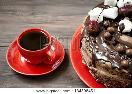 Cup Coffe And Big Chocolate Cake With Chocolate Frosting And Cherry