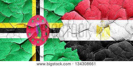 Dominica flag with egypt flag on a grunge cracked wall
