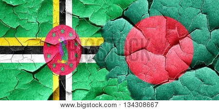 Dominica flag with Bangladesh flag on a grunge cracked wall