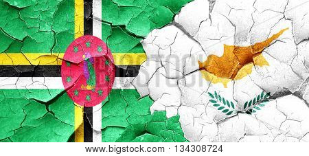 Dominica flag with Cyprus flag on a grunge cracked wall