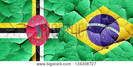 Dominica flag with Brazil flag on a grunge cracked wall