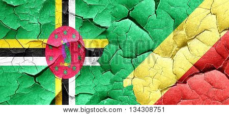 Dominica flag with congo flag on a grunge cracked wall