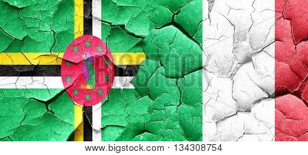 Dominica flag with Italy flag on a grunge cracked wall