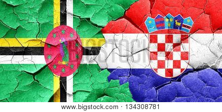 Dominica flag with Croatia flag on a grunge cracked wall