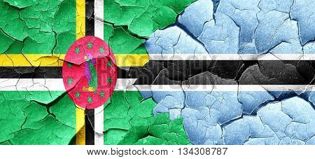 Dominica flag with Botswana flag on a grunge cracked wall