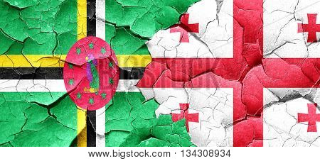 Dominica flag with Georgia flag on a grunge cracked wall