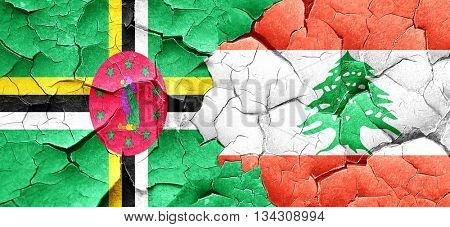 Dominica flag with Lebanon flag on a grunge cracked wall