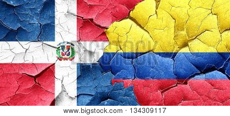 dominican republic flag with Colombia flag on a grunge cracked w