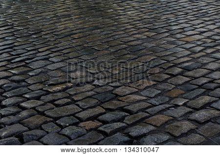 Geometry pattern background of wet cobblestone pavement