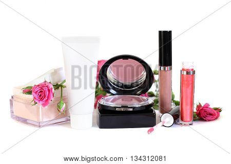 Cosmetics - makeup powder cream blush lip gloss and flowers on white background